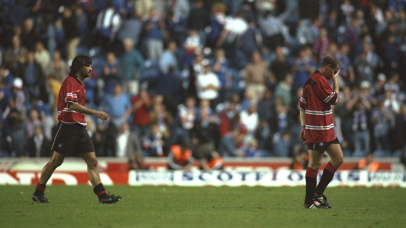 Paul Gascoigne (right) and Marco Negri of Rangers walk off the field after playing IFK Gothenburg in 1997