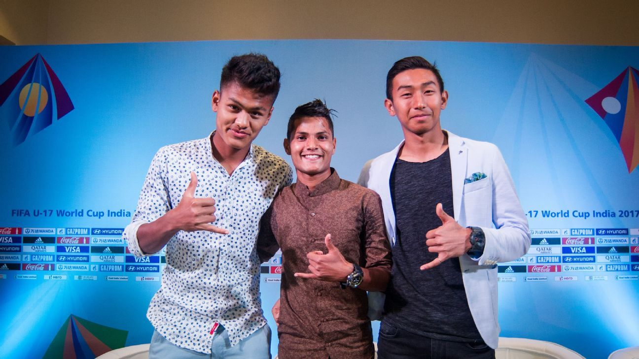 Indian U-17 football players Jackson Singh (L), Sanjeev Stalin (C) and Dheeraj Singh pose for a photo before the draw.