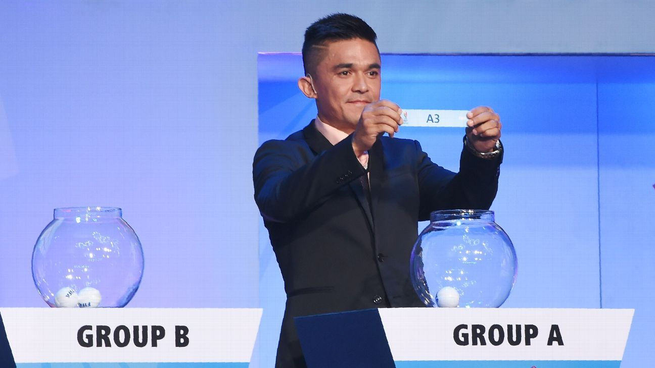 Indian national football team captain Sunil Chhetri shows a group position during U-17 World Cup draw.