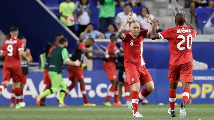 Scott Arfield and Patrice Bernier celebrate after a Alphonso Davies goal in Canada's Gold Cup win against French Guiana.