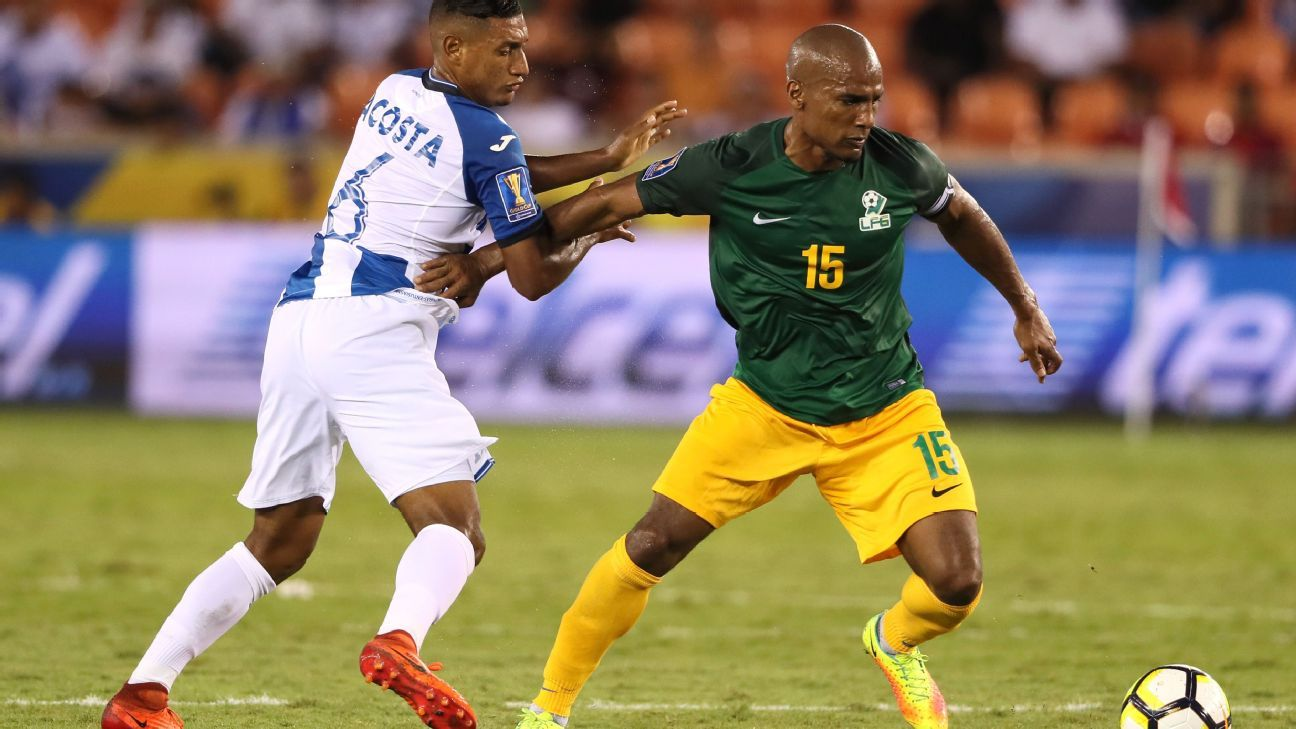 Bryan Acosta, left, and Florent Malouda in action during Honduras' and French Guiana's Gold Cup match on Tuesday.
