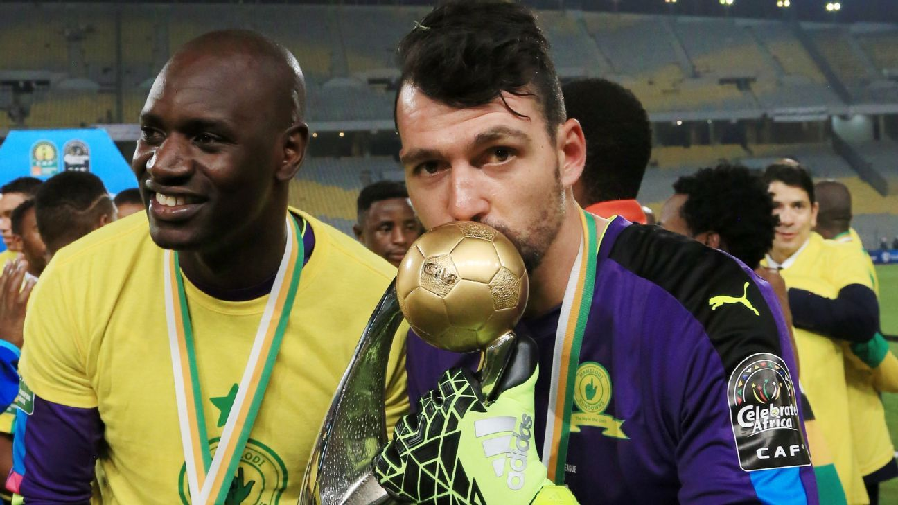 Wayne Sandilands celebrates with the trophy after Mamelodi Sundowns win the 2016 CAF Champions League