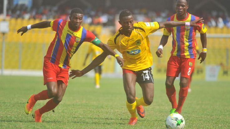 Thomas Abbey of Accra Hearts of Oak challenge Ahmed Adams of Kumasi Asante Kotoko during a Ghana Premier League match.