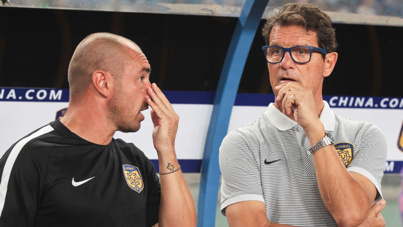 Capello watches his team play.