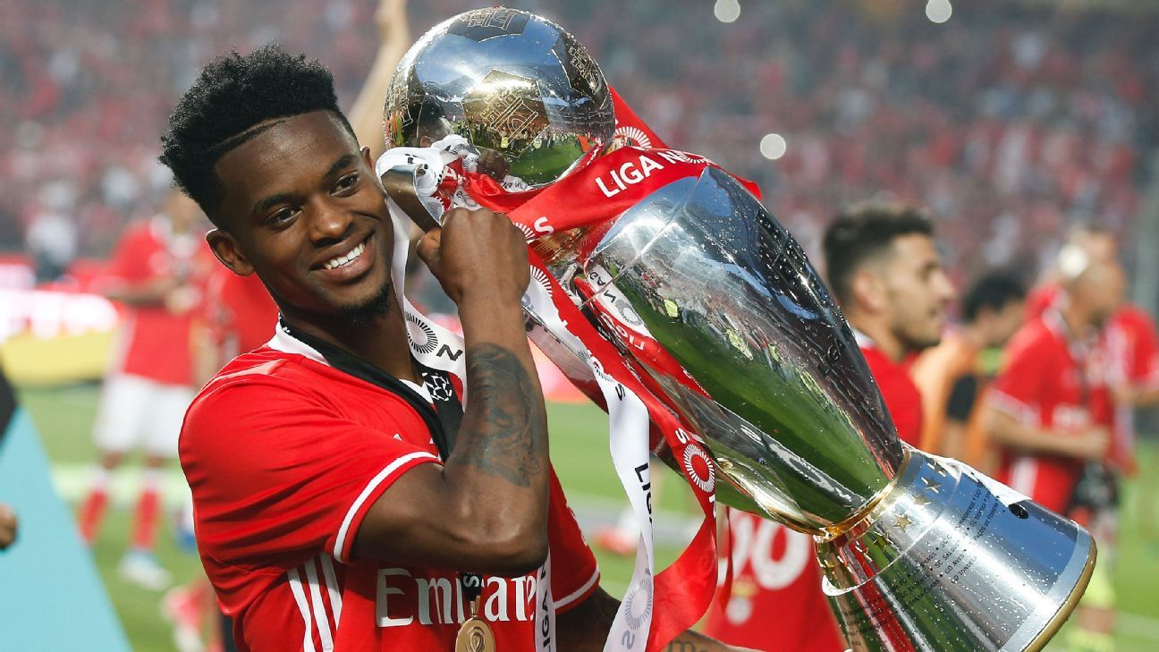 Nelson Semedo holds the trophy after Benfica won their 36th league title.