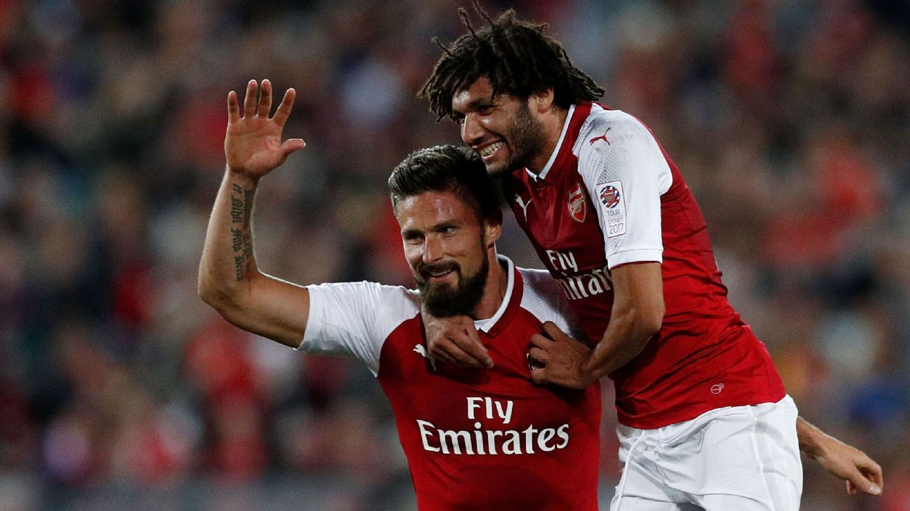 Olivier Giroud Mohamed Elneny celebrate a goal for Arsenal during the preseason friendly game against Western Sydney Wanderers.