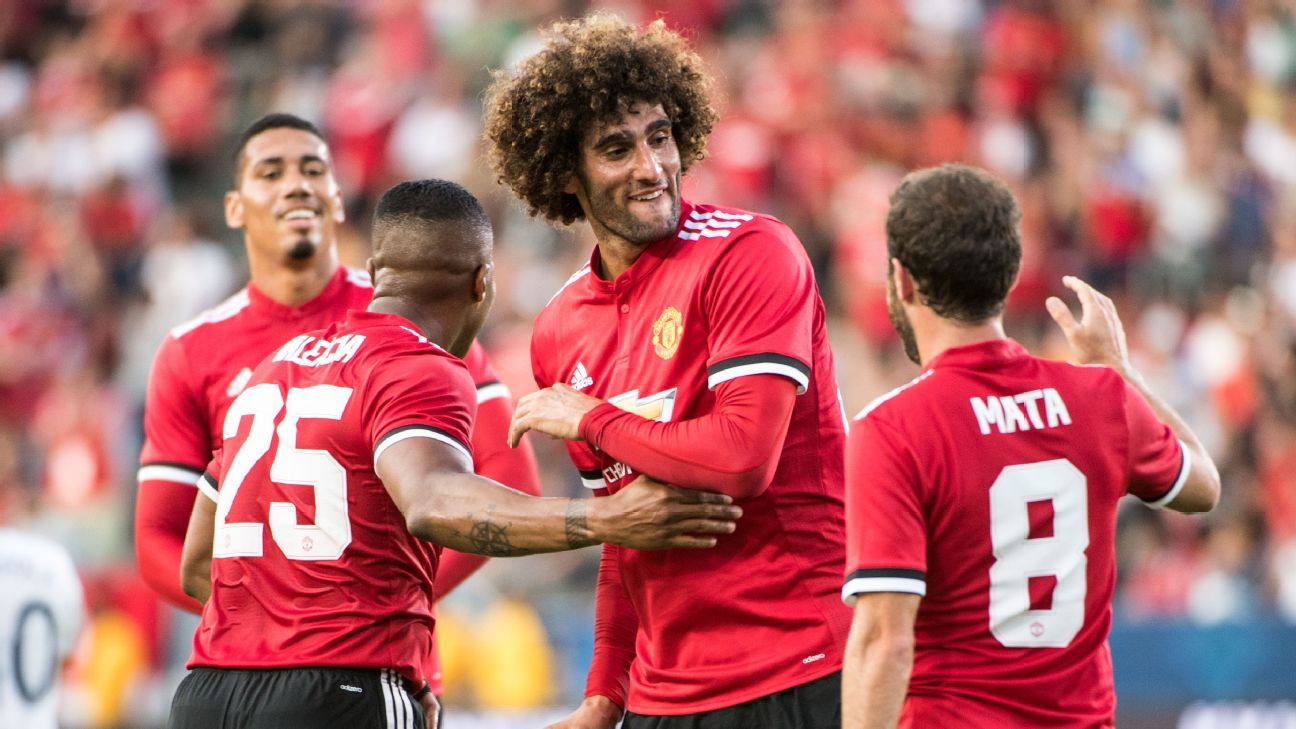 Manchester United's Marouane Fellaini celebrates.