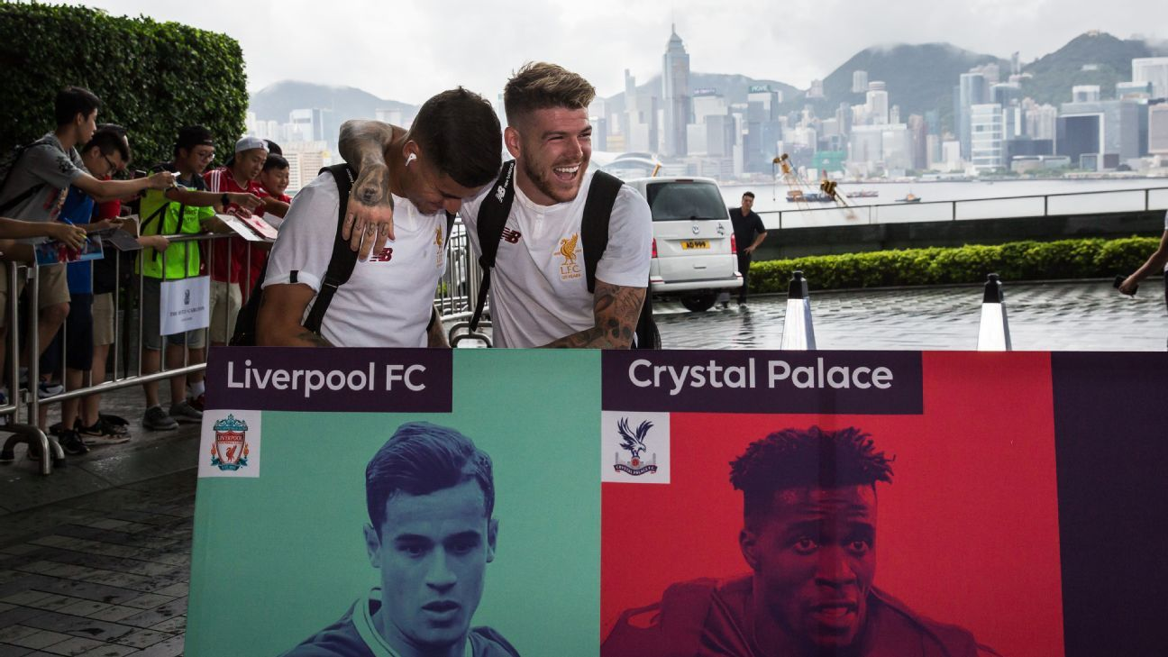 Alberto Moreno and Philippe Coutinho arrive in Hong Kong for the Premier League Asia Trophy.