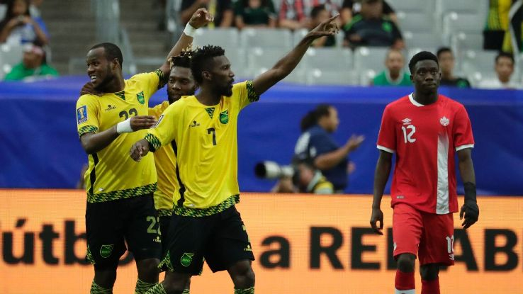 Romario Williams and his Jamaica teammates celebrate after scoring a goal against Canada in the Gold Cup.