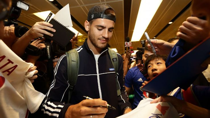 New Chelsea striker Alvaro Morata arrives in Singapore.