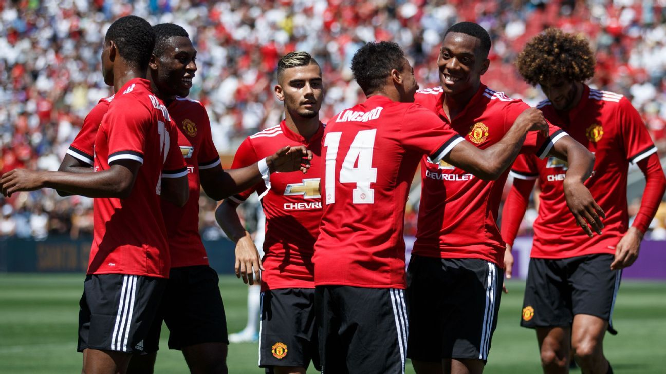 Manchester United players celebrate after Anthony Martial opened the scoring against Real Madrid.
