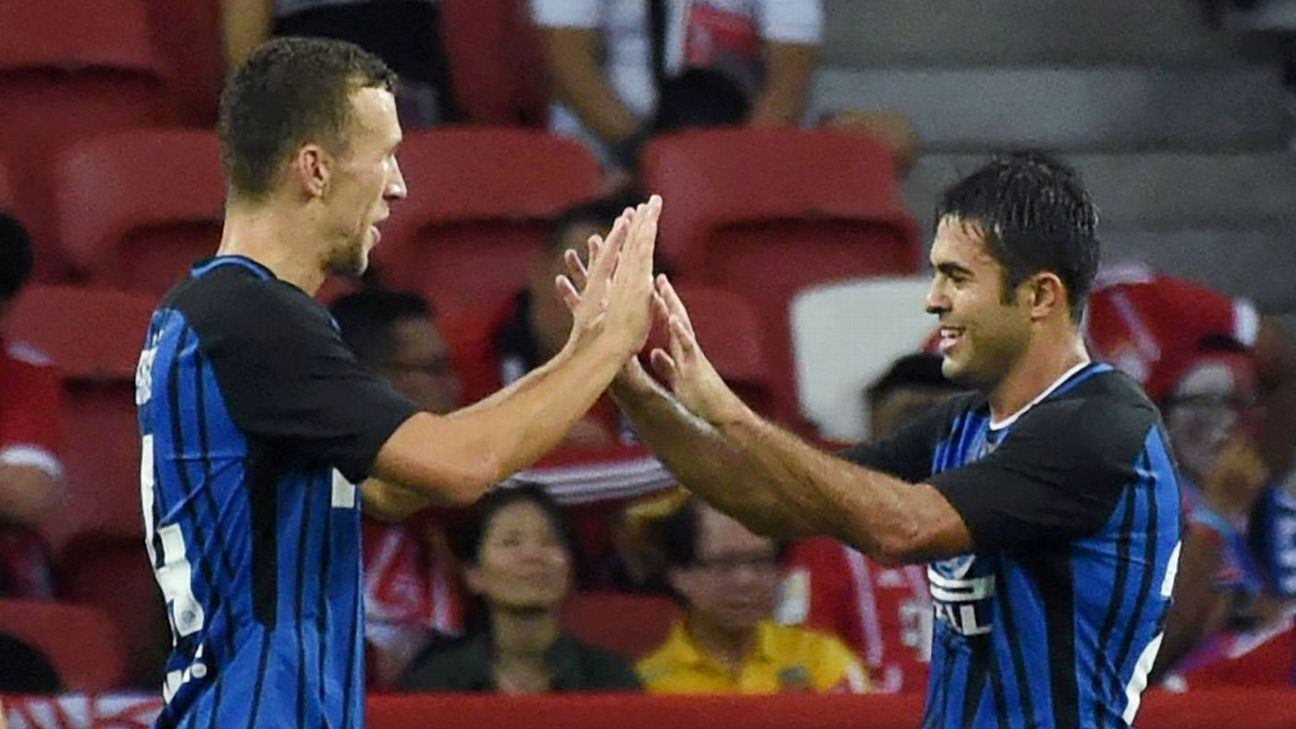 Eder celebrates with Ivan Perisic after scoring for Inter.
