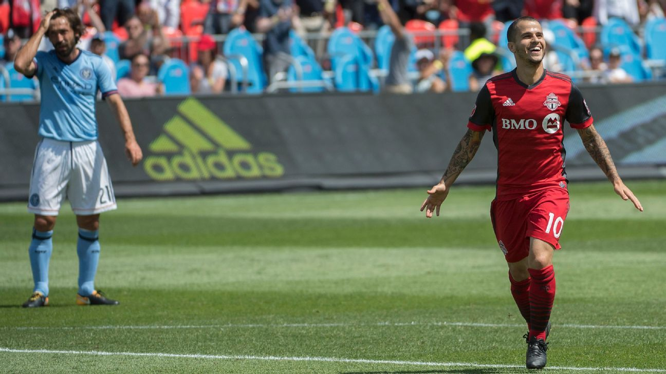 Sebastian Giovinco celebrates one of his two goals on Sunday.