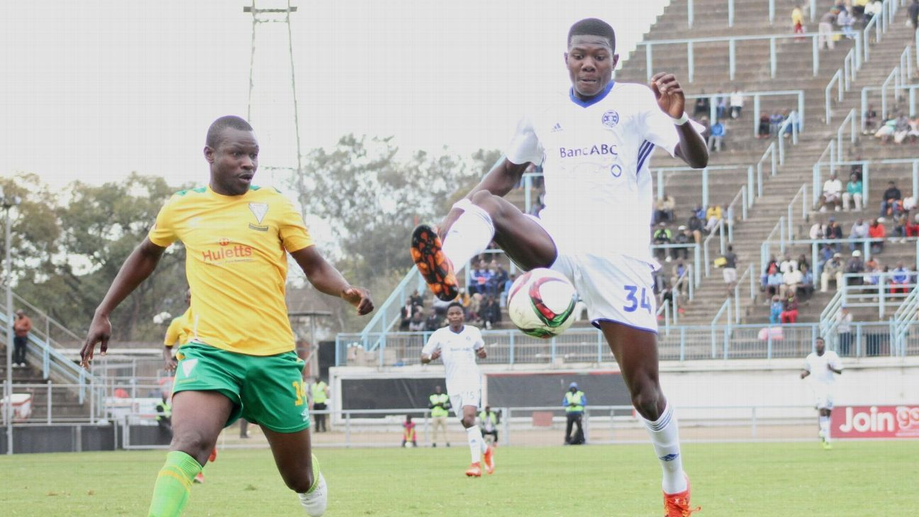 Triangle's Guthrie Zhokinyi battles it out with Dynamos' Takunda Macheka