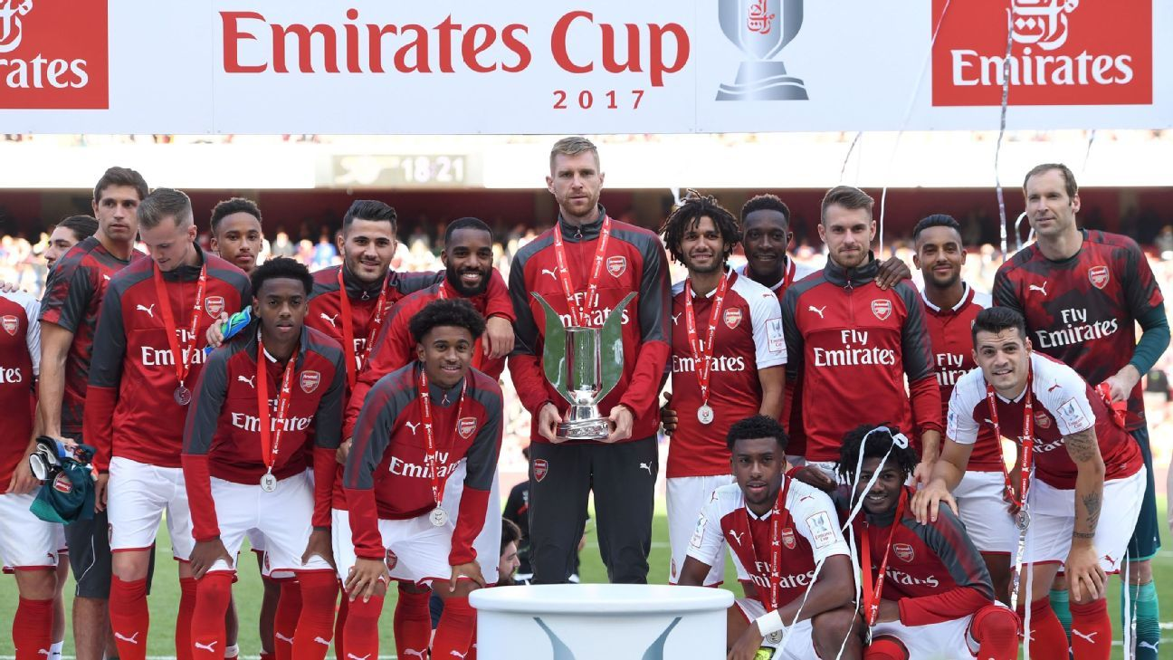 Arsenal captain Per Mertesacker holds the Emirates Cup trophy