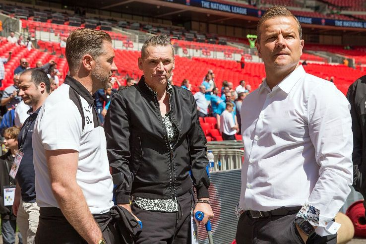 Forest Green chairman Dale Vince, centre, confers with assistant manager Scott Lindsey, left, and manager Mark Cooper at the National League promotion match at Wembley.