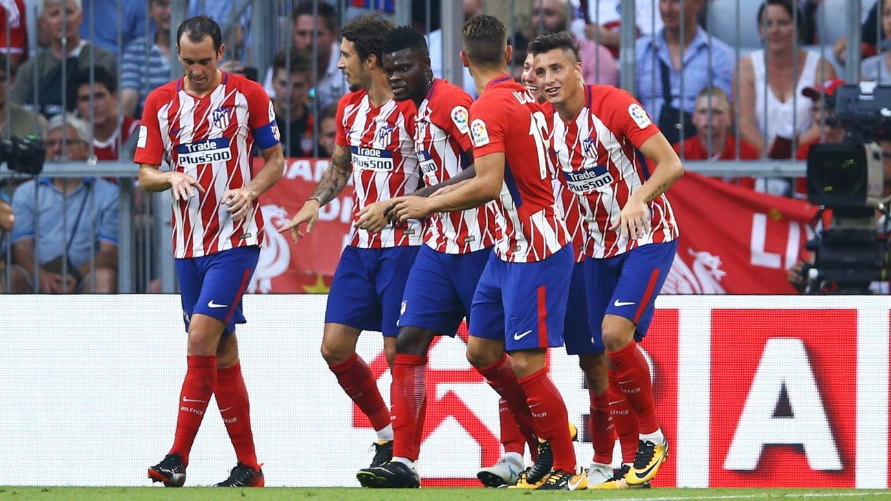 Atletico Madrid celebrate Fernando Torres' goal on Tuesday.