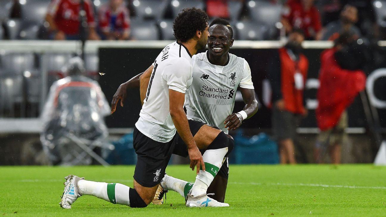 Mohamed Salah, left, and Sadio Mane celebrate after scoring a goal for Liverpool against Bayern Munich.