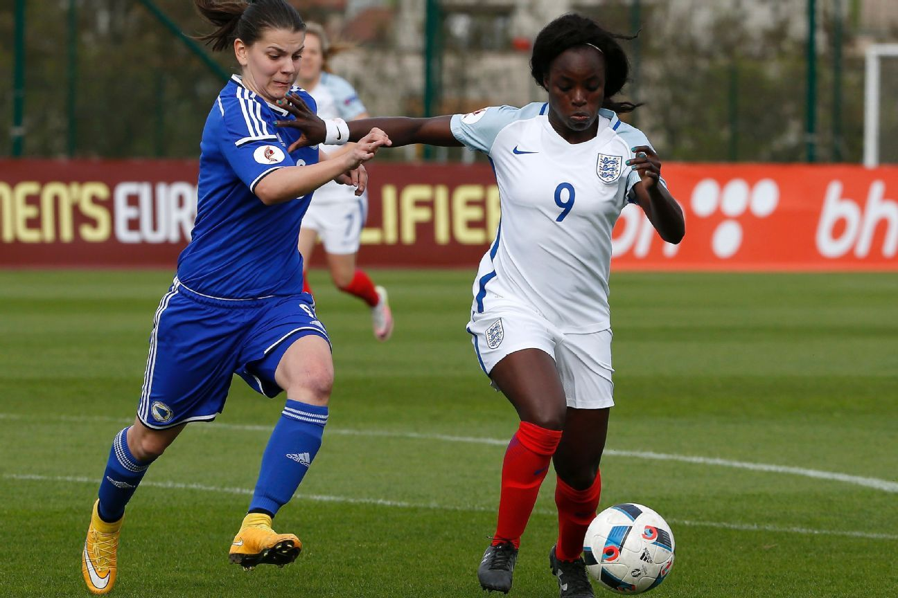 Eniola Aluko of England is challenged by Melisa Hasanbegovic of Bosnia during a UEFA Women's European Championship Qualifier in 2016.