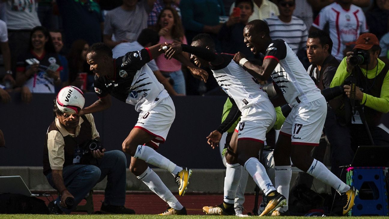 Lobos BUAP celebrate a goal in their debut season in Mexico's top flight.