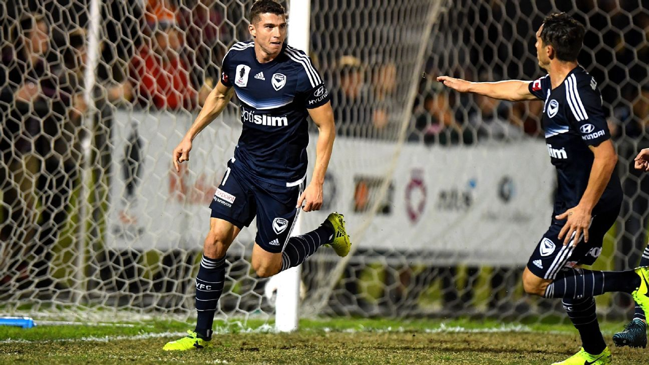 Mitchell Austin of Melbourne Victory celebrates his goal against Brisbane Roar.