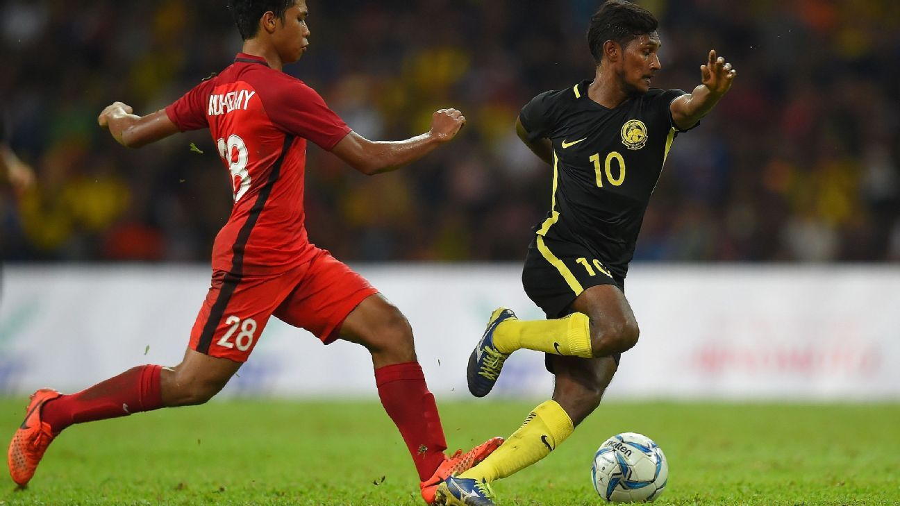 Kumaahran of Malaysia v Singapore in SEA Games