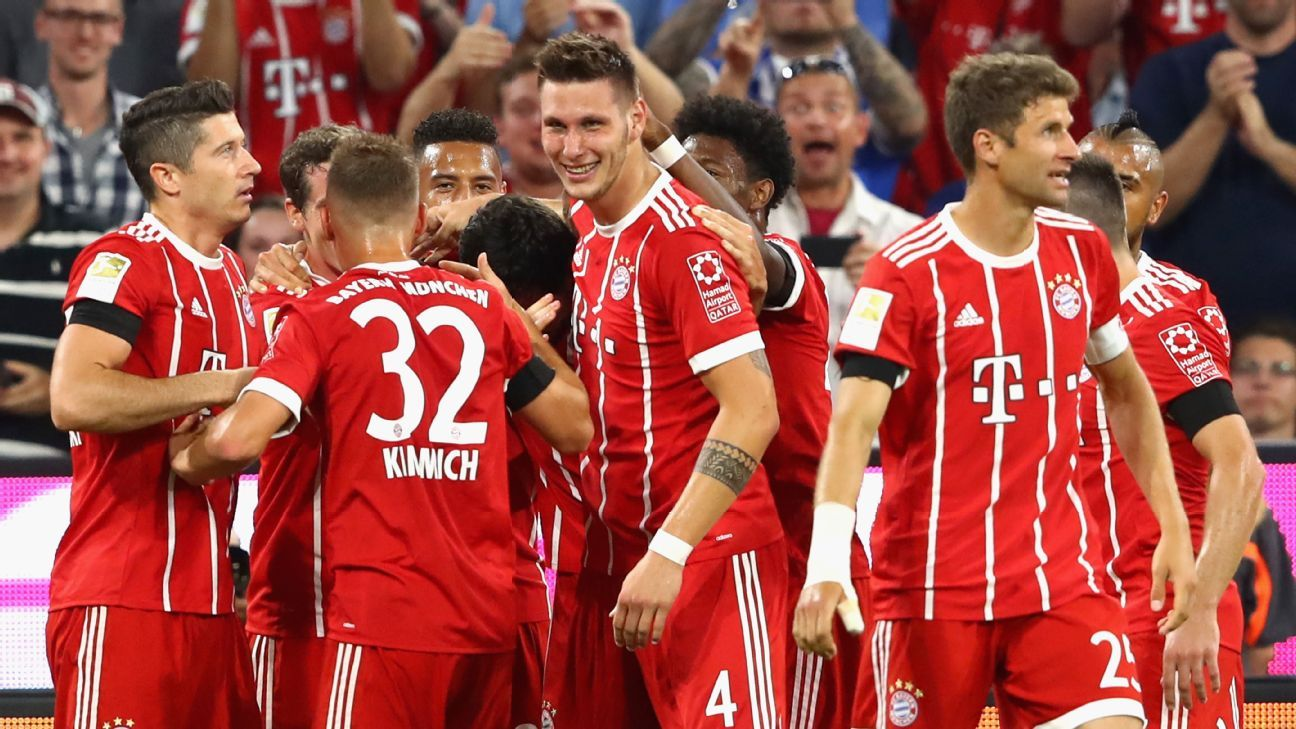 Bayern Munich players celebrate after Niklas Sule, center, opened the scoring against Bayer Leverkusen.
