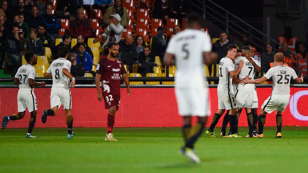 Monaco players celebrate after a Radamel Falcao goal in their team's win against Metz in Ligue 1.