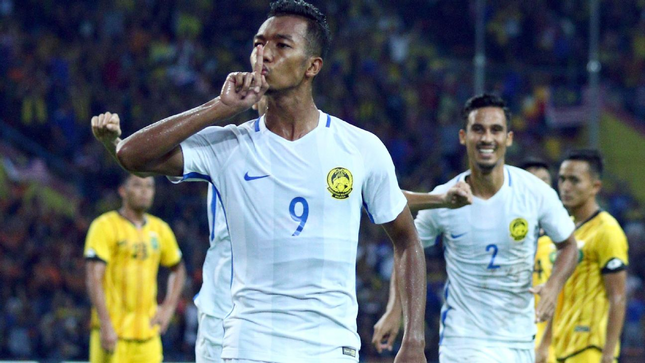 Adam Noor of Malaysia scores v Brunei in SEA Games