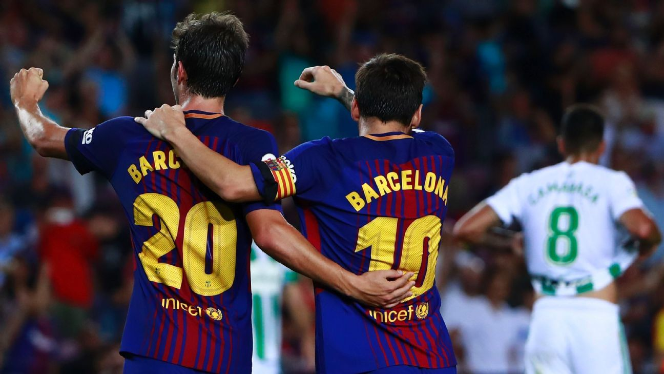 Sergi Roberto, left, and Lionel Messi celebrate after scoring a goal in a win against Real Betis.