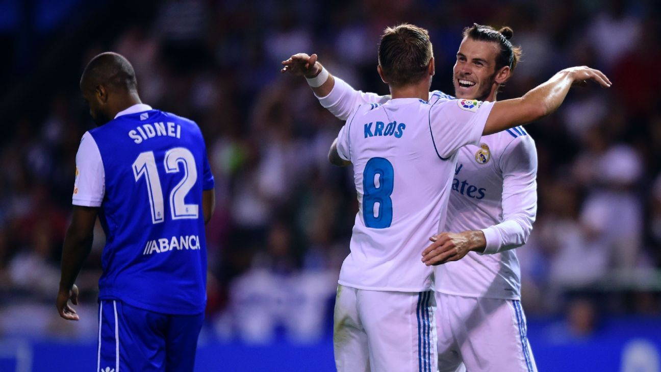Toni Kroos, left, and Gareth Bale celebrate after scoring a goal against Deportivo in an easy win for Real Madrid.