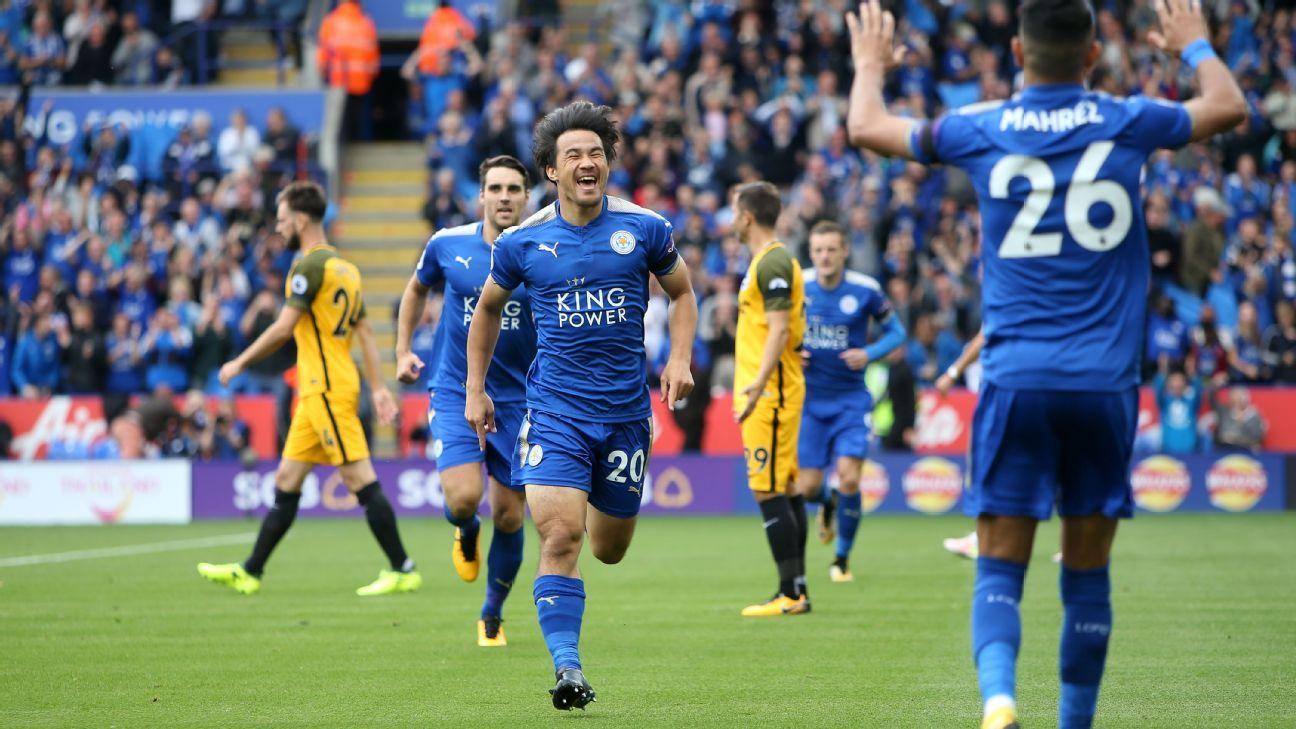 Shinji Okazaki of Leicester City celebrates with Riyad Mahrez