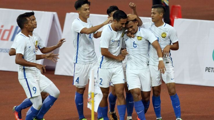 Malaysia celebrate winning SEA Games goal v Indonesia