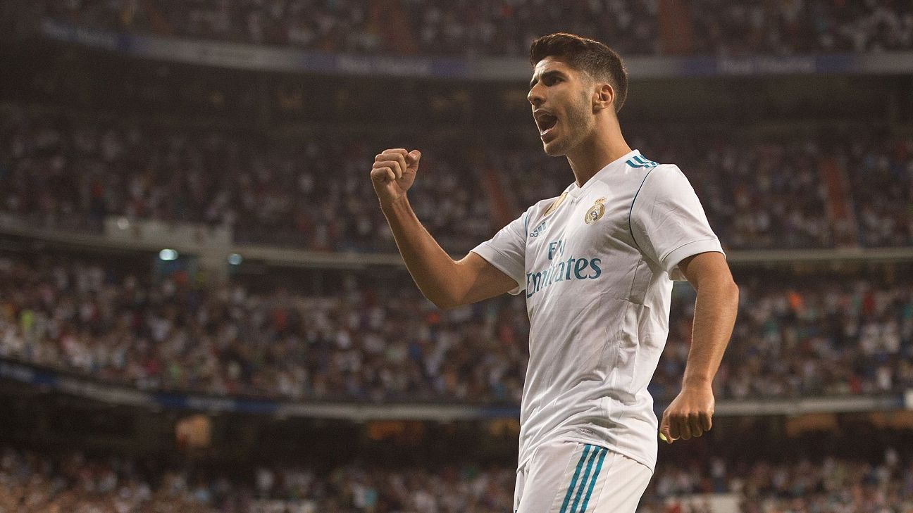 Marco Asensio celebrates one of his goals against Valencia.