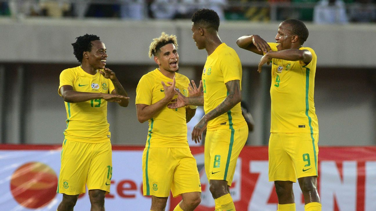 Percy Tau of South Africa (l) celebrates goal with teammates (l-r) Keagan Dolly, Bongani Zungu and Lebogang Manyama during the 2019 Afcon football qualifier between Nigeria and South Africa at Godswill Akpabio International Stadium in Uyo.