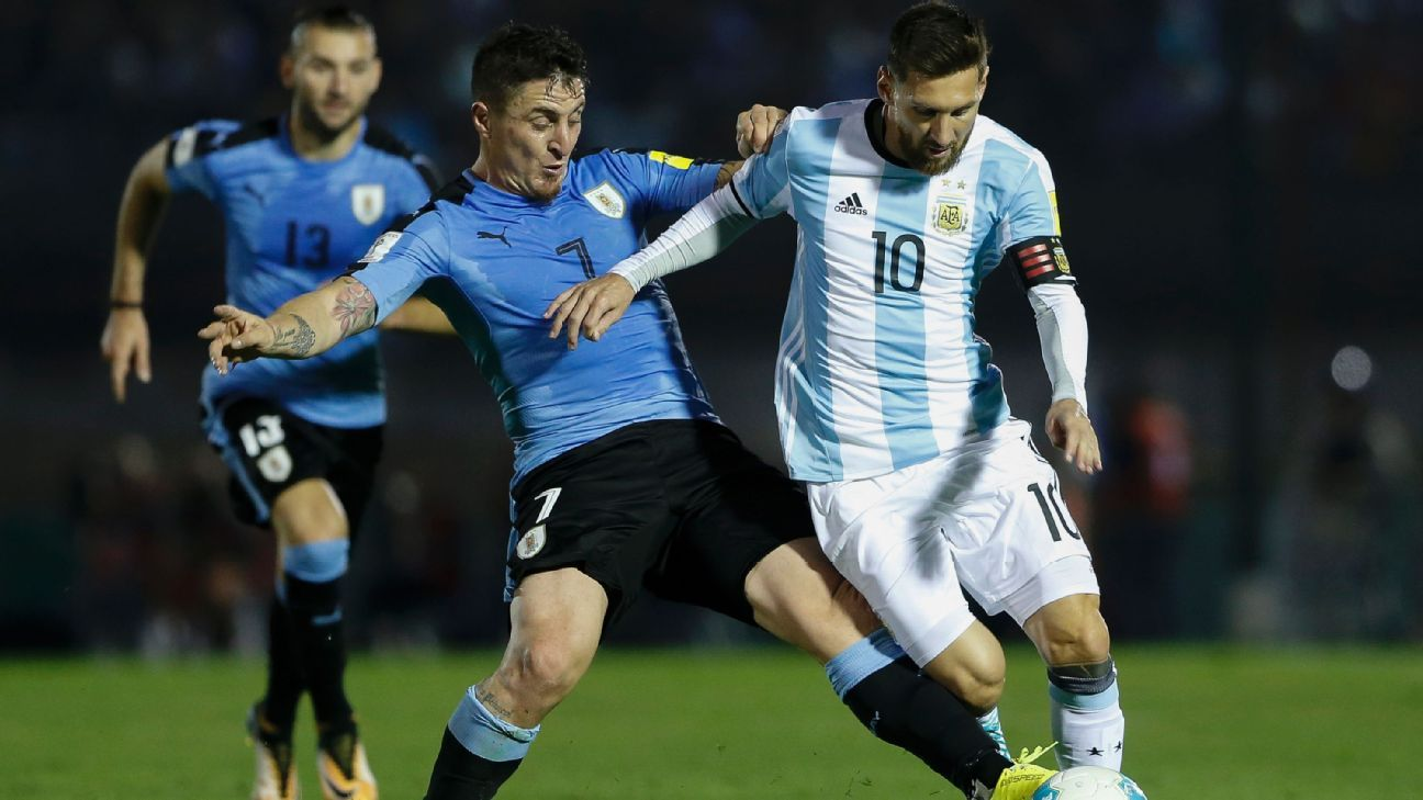 Lionel Messi and Cristian Rodriguez vie for the ball in a World Cup qualifier between Argentina and Uruguay.