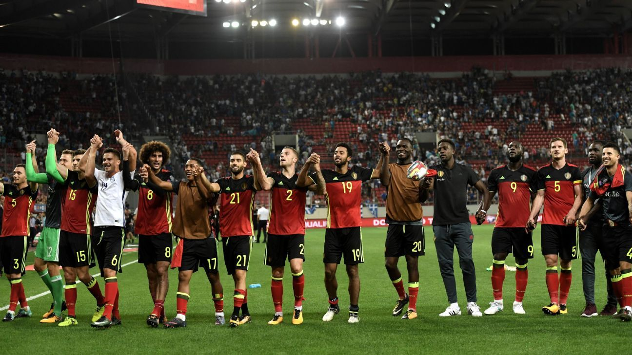 Belgium players celebrate after qualifying for the 2018 World Cup.