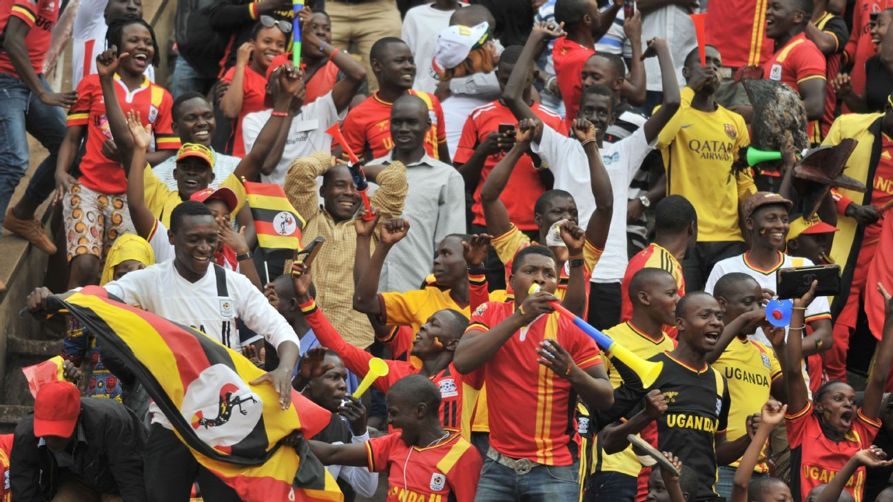Uganda supporters celebrate during their FIFA World Cup qualifier against Egypt; the 1-0 victory took the Cranes to the top of Africa's Group E.