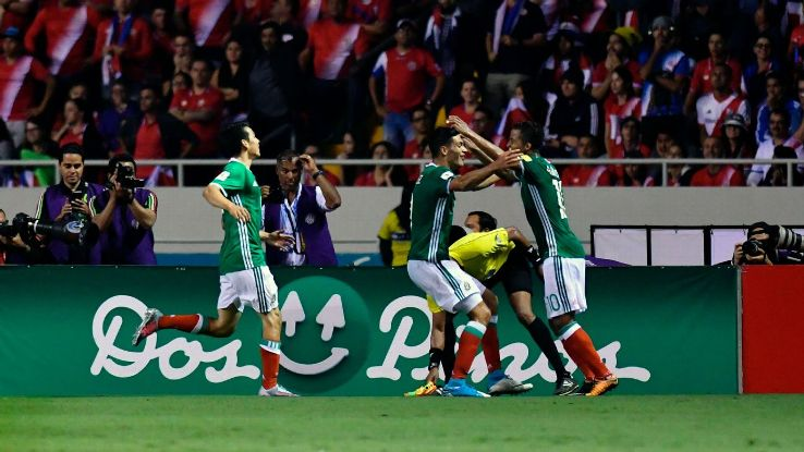 Mexico players celebrate after scoring a goal against Costa Rica in a World Cup qualifier.