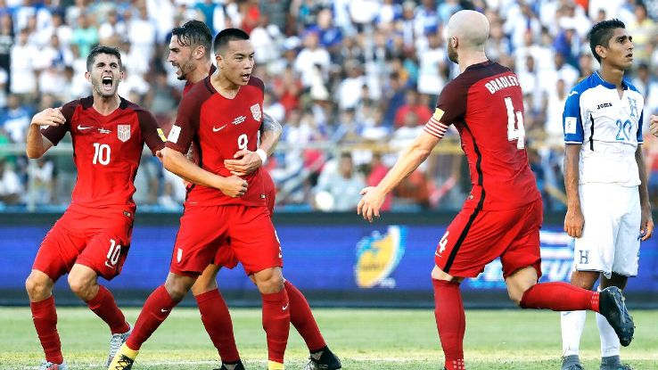 Bobby Wood and the United States celebrate after scoring a goal against Honduras.