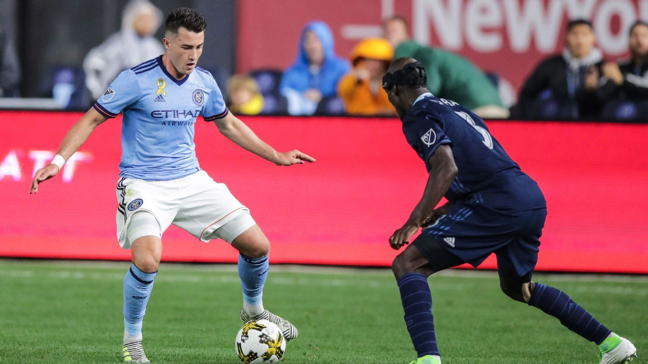 Ike Opara, right, plays defense on NYCFC's Jack Harrison, who scored his team's winner against Sporting KC.