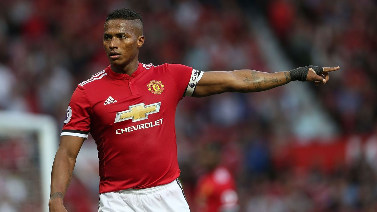 Manchester United's Antonio Valencia limps off injured in friendly