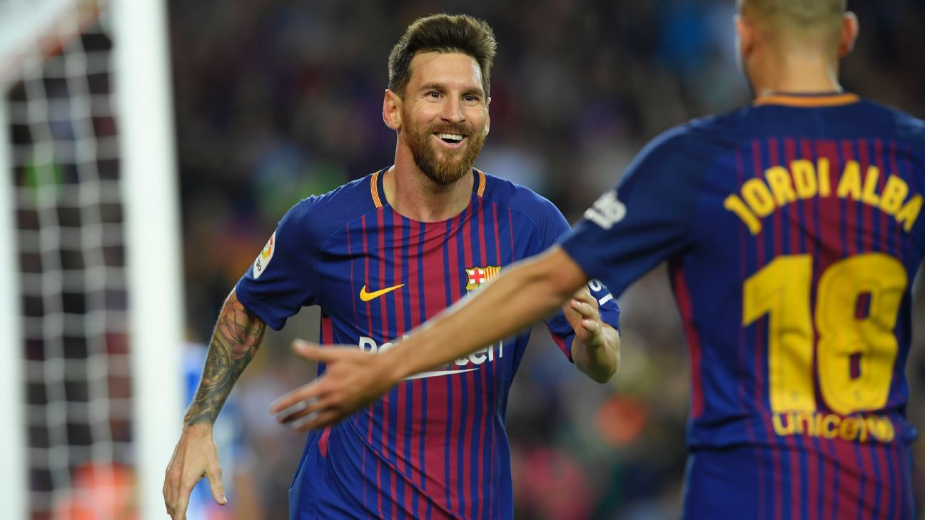 Lionel Messi's hat trick helped Barcelona remain perfect in La Liga.