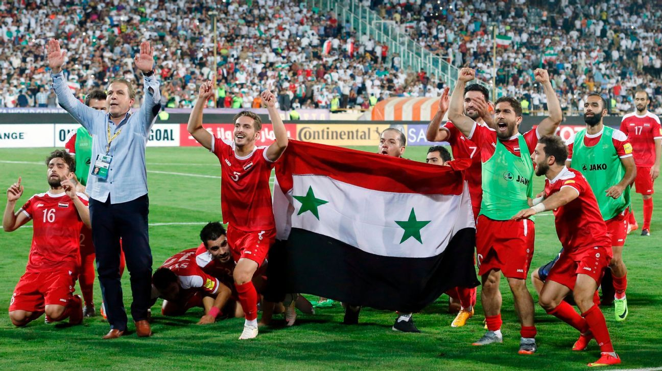 Syria's players celebrate after drawing their FIFA World Cup 2018 qualifier against Iran in Tehran on September 5, 2017. The result helped Syria finish third in their group and keep their WC qualification hopes alive.