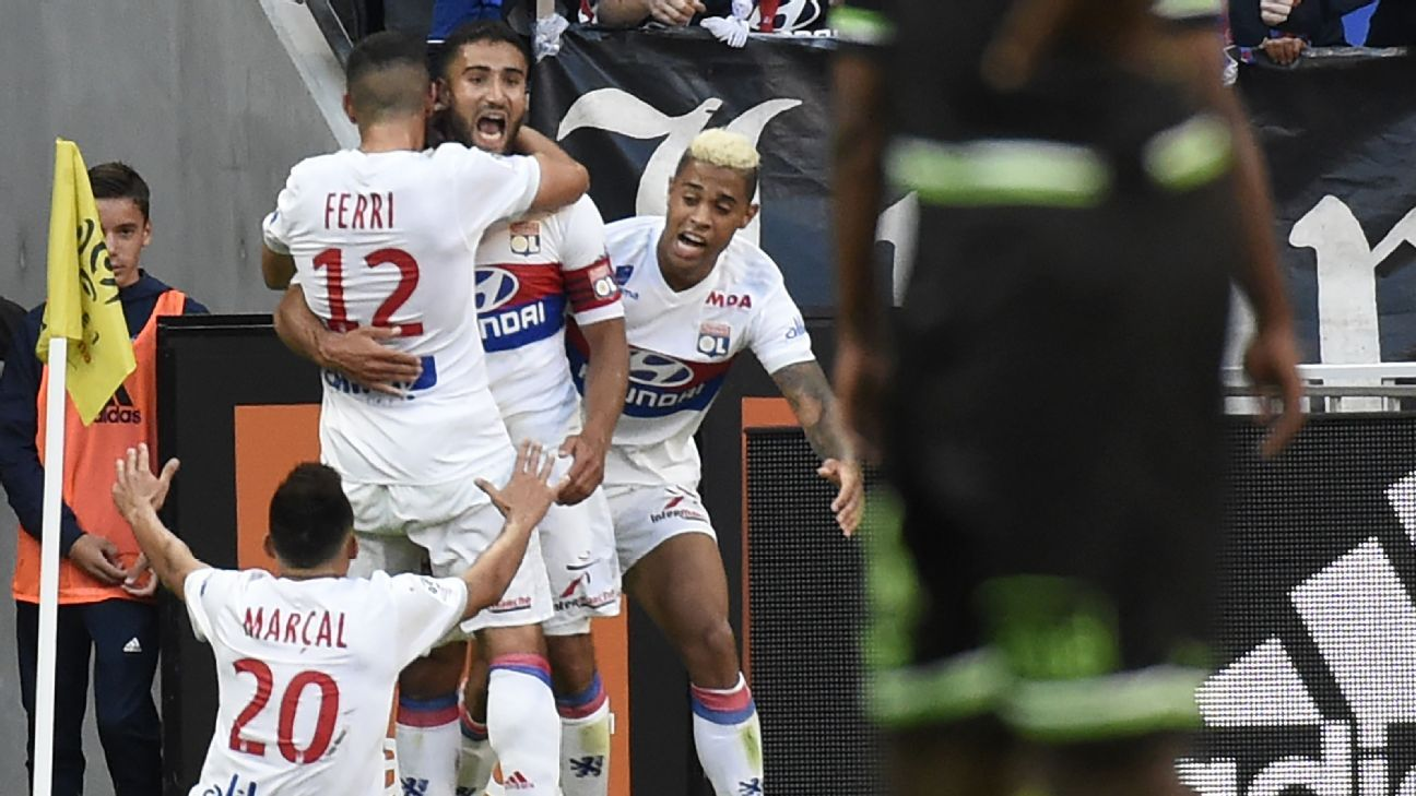 Lyon players celebrate after scoring a goal in a Ligue 1 victory against Guingamp.