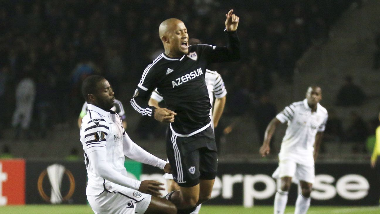 Dino Ndlovu of Qarabag vies for the ball with  Fernando Vareia of PAOK
