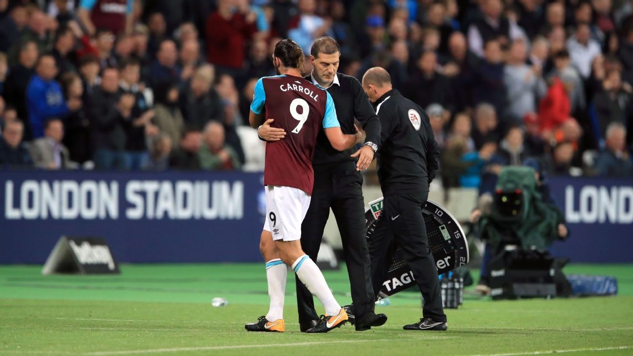 Slaven Bilic embraces Andy Carroll