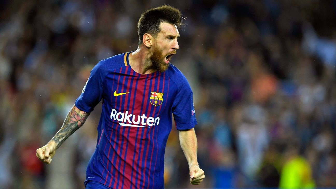 Barcelona's forward from Argentina Lionel Messi celebrates after scoring during the UEFA Champions League Group D football match FC Barcelona vs Juventus at the Camp Nou stadium in Barcelona on September 12, 2017.
