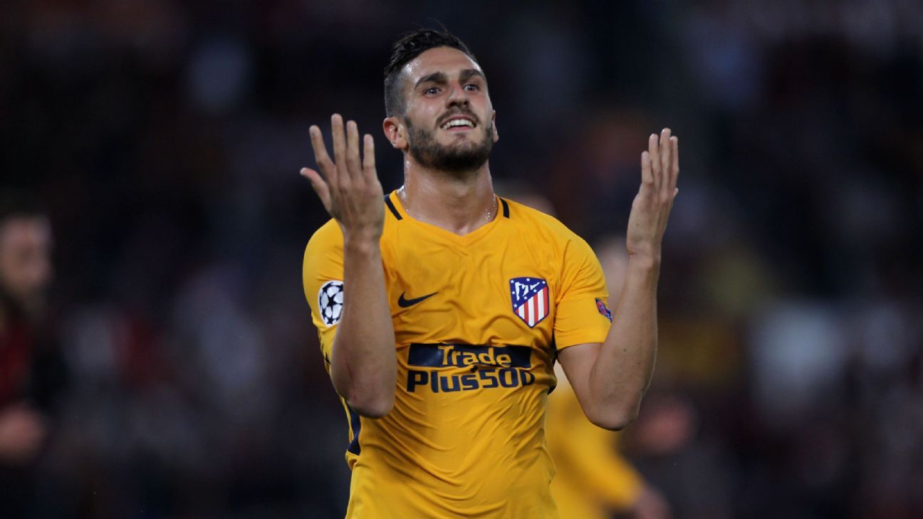 Koke reacts after a missed chance for Atletico Madrid in a 0-0 draw against Roma.