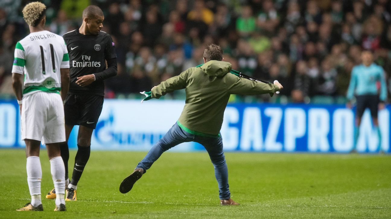 Kylian Mbappe is confronted by a supporter during Paris Saint-Germain's Champions League victory against Celtic.